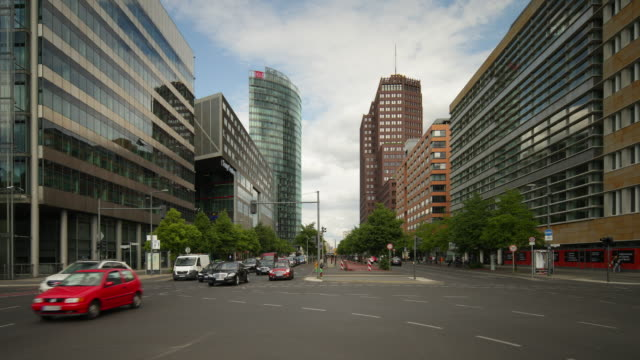 berlin potsdamer platz modern skyline with traffic - road junction stock-videos und b-roll-filmmaterial