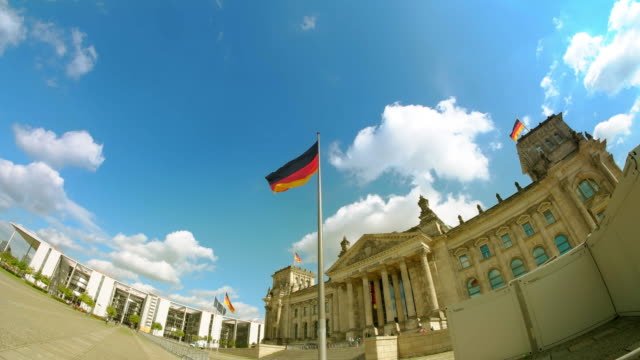berlin reichstag building, german flag and sky, sunny - chancellor of germany stock videos & royalty-free footage