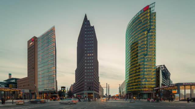 berlin skyline on potsdamer platz timelapse from day to night with traffic dynamic - zeitraffer tag bis nacht stock-videos und b-roll-filmmaterial