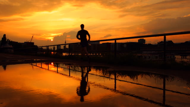 Berlin Skyline Sunset Reflection with Silhouette of a runner