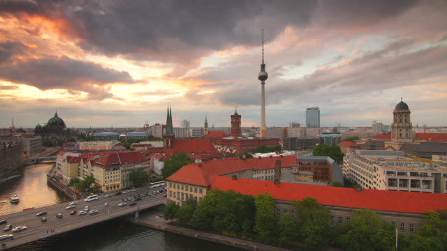 berlin skyline with dramatic clouds and traffic - establishing shot stock-videos und b-roll-filmmaterial