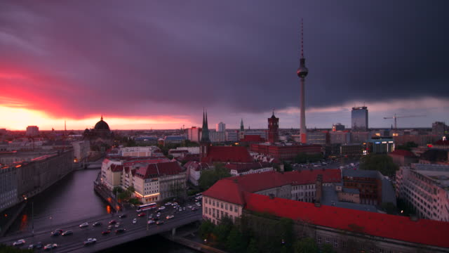 berlin skyline with dramatic clouds sunset and traffic - establishing shot stock-videos und b-roll-filmmaterial