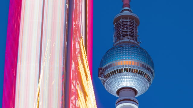 Berlin Television Tower with Colorful Ferris Wheel in Motion Timelapse