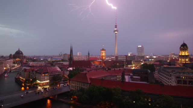 berlin thunderstorm night skyline with traffic - establishing shot stock-videos und b-roll-filmmaterial
