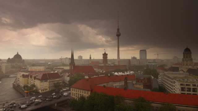 Berlin Thunderstorm Skyline with dramatic Clouds heavy Rain and Traffic