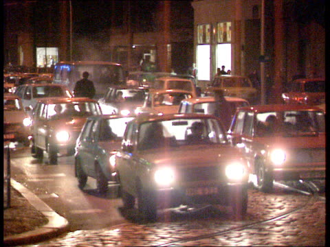 berlin wall: border opening reactions; day neon sign indicates 11.13 am and 05 c long queue of cars waiting to pass through crossing crowd of e... - souvenir stock videos & royalty-free footage