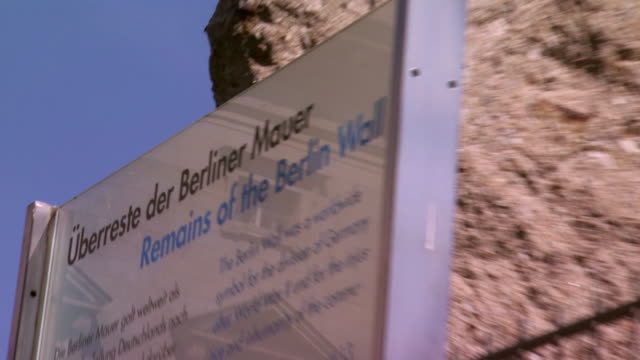 cu zo ms berlin wall covered with information sign / berlin, germany - information sign stock videos & royalty-free footage