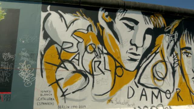 berlin wall, grafitti, murals,pan - artistic product stock videos & royalty-free footage