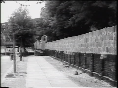 berlin wall under construction next to sidewalk / west berlin / cold war / germany - surrounding wall stock videos & royalty-free footage