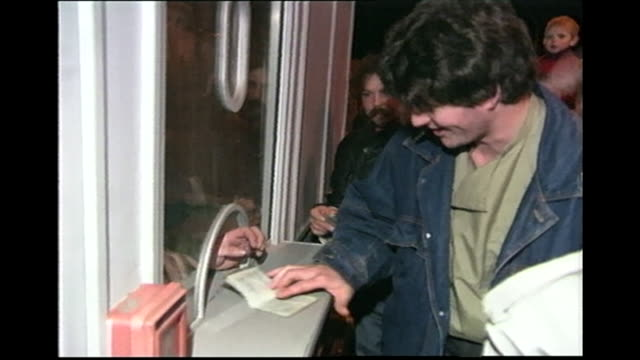 stockvideo's en b-roll-footage met berliners queuing at checkpoint to get an official stamp on their papers to show they were there the night the berlin wall fell, 1989 - 1980 1989