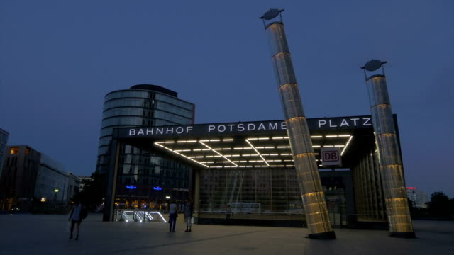 berlin,potsdamerplatz, people walking past u bahn,night time, - german culture stock videos & royalty-free footage