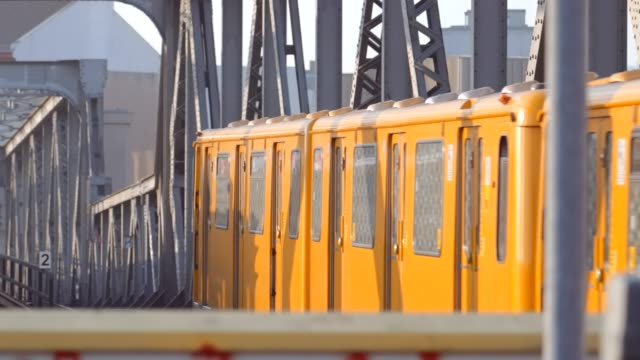 berlin's iconic subway trains crossing each other on a bridge - yellow stock videos & royalty-free footage