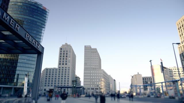 berlin's potsdamer platz hyperlapse video - bahnhof stock-videos und b-roll-filmmaterial