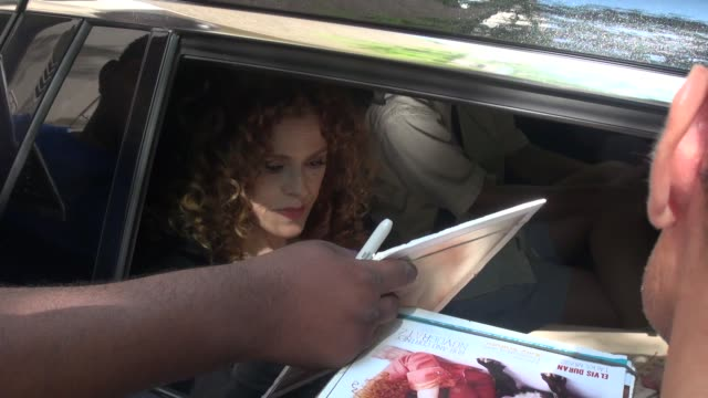 bernadette peters greets fans from her car outside of the live with kelly michael show celebrity sightings in new york on july 07 2014 in new york... - バーナデット ピータース点の映像素材/bロール
