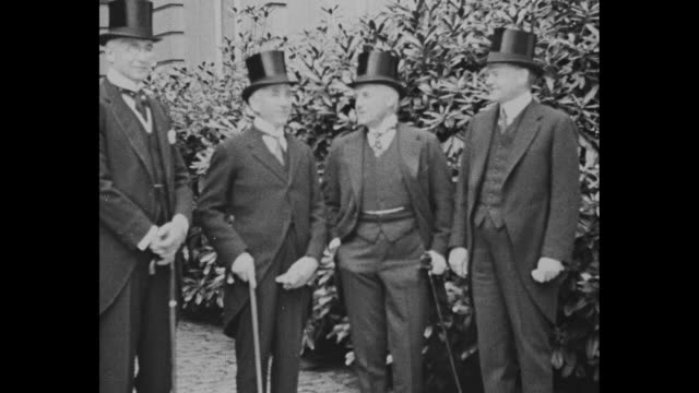bernard baruch norman davis vance mccormick and herbert hoover stand outdoors in suits and top hats during june 1919 peace conference in brussels /... - herbert hoover us president stock videos & royalty-free footage