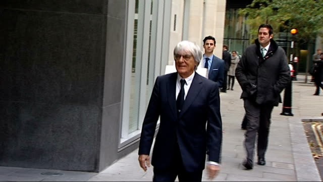bernie ecclestone court case: arrivals; england: london: high court: ext bernie ecclestone along from car and through revolving doors into court -... - bernie ecclestone stock videos & royalty-free footage