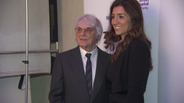 broll bernie ecclestone fabiana flosi at zoom f1 charity auction at intercontinental park lane hotel on january 16 2015 in london england - fabiana flosi stock videos & royalty-free footage