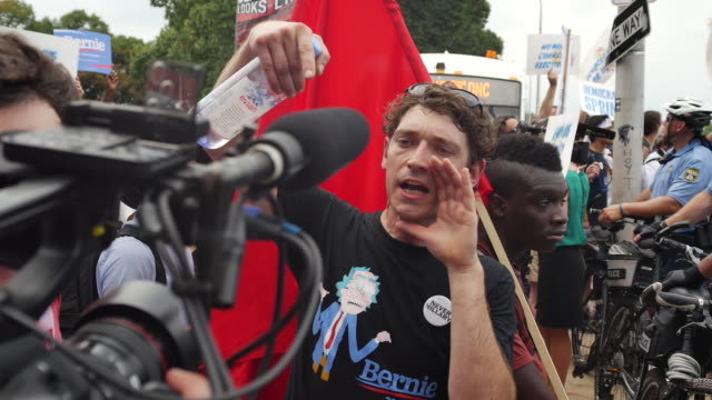 Bernie Sanders supporter protests against a CNN cameraman on the first day of the Democratic National Convention