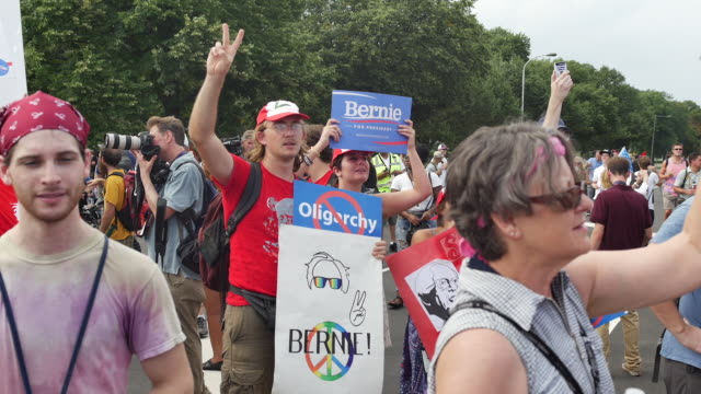 bernie sanders supporters protest outside the wells fargo center on the first day of the democratic national convention - bernie sanders stock videos & royalty-free footage