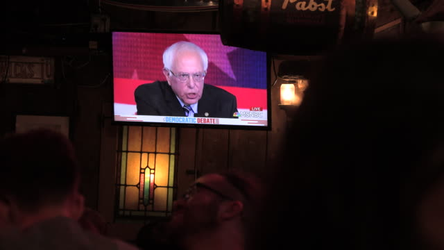 bernie sanders supporters watch the second night of the democratic debate during a bernie sanders debate watch party at nick's english hut on... - debatte stock-videos und b-roll-filmmaterial