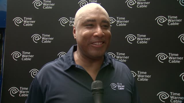 interview bernie williams talks mlb allstar game and playing guitar at time warner cable's launch of twc wifi in manhattan at time warner center on... - time warner center stock videos & royalty-free footage