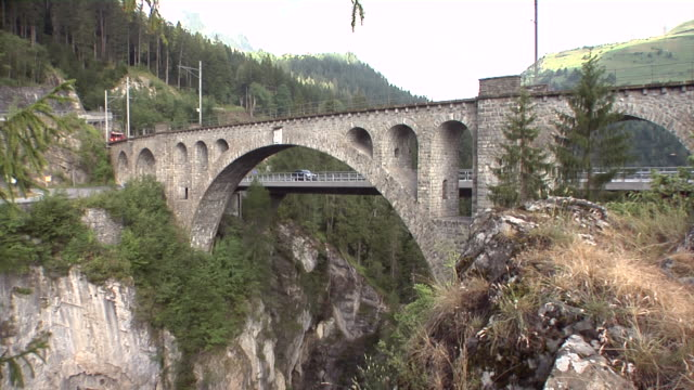 bernina express drives over the solis viaduct - viaduct stock videos & royalty-free footage