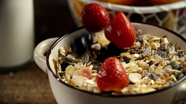 berries falling into bowl with muesli cereals - protein bar stock videos & royalty-free footage