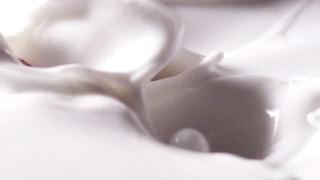 berries falling into yogurt - freshness stock videos & royalty-free footage