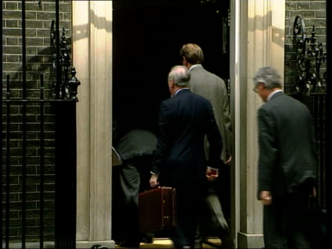 london ext/itn bertie ahern arrive at downing street/ gvs ahern others out of car into number 10/ blair ahern out of number 10 onto steps for... - bertie ahern stock videos and b-roll footage