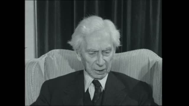 bertrand russell interview:; england: london: 43 hasker street: int 2-shot: bertrand russell interview sof: - he thinks that both sides are engaged... - excitement stock videos & royalty-free footage