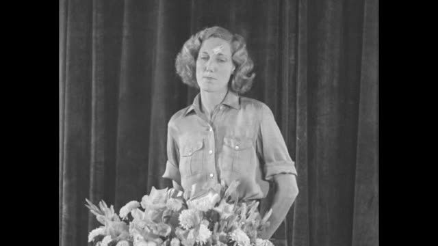 beryl markham exits plane after landing at floyd bennett field after her first solo flight from london / markham, surrounded by reporters, waves in... - looking at camera stock videos & royalty-free footage