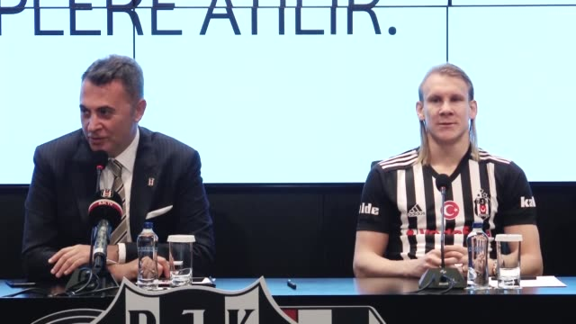 Besiktas chairman Fikret Orman introduces new player Domagoj Vida during a press conference at Vodafone Park Stadium in Istanbul Turkey on January 03...