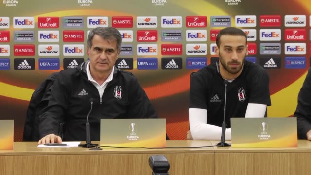 besiktas' head coach senol gunes and forward cenk tosun attend a press conference the day before the uefa europa league round of 32 first leg soccer... - senol guenes stock videos and b-roll footage