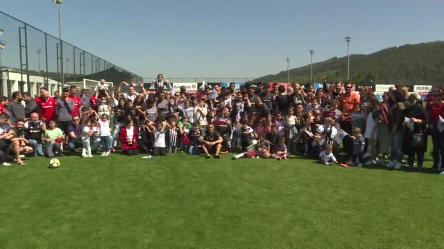 besiktas' head coach senol gunes and his players celebrate national sovereignty and children's day with a group of children at nevzat demir facility... - senol guenes stock videos and b-roll footage