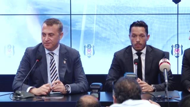 Besiktas' s new transfer Adriano Correia Claro and Besiktas Club President Fikret Orman speak to media members during the contract signing ceremony...