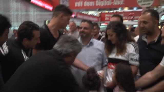 besiktas's new transfer german striker mario gomez greets the fans at the airport as he arrives in vienna to attend besiktas' austria camp on july 31... - besiktas stock videos and b-roll footage