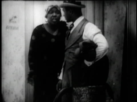 1929 MONTAGE Bessie Smith and Jimmy Mordecai talking in a scene from the movie St. Louis Blues / New York City, New York, United States