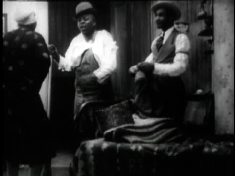 1929 MONTAGE Bessie Smith arguing with a man in a scene from the movie St. Louis Blues / New York City, New York, United States