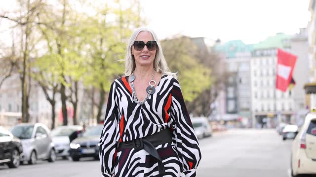 best ager model and influencer petra van bremen wearing a black, white and orange-red zebra print longsleeve v-neck shirt by madeleine, a black,... - zebra print stock videos & royalty-free footage