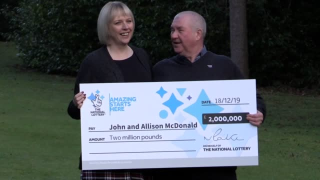 best audio/quality available a couple who won a £2 million lottery jackpot three days before finding out that their teenage son is clear of cancer... - millionnaire stock videos & royalty-free footage