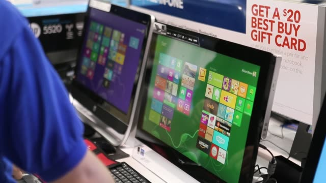 best buy employee assisting customer on showing microsoft windows 8 operating system on display on a computer best buy employee and customer testing... - orem utah stock videos and b-roll footage