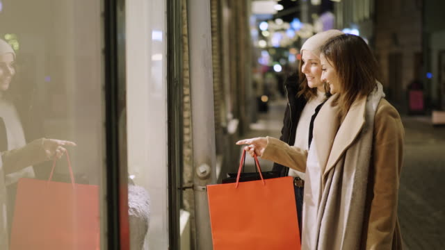 best friends are window shopping for christmas holidays - retail stock videos & royalty-free footage