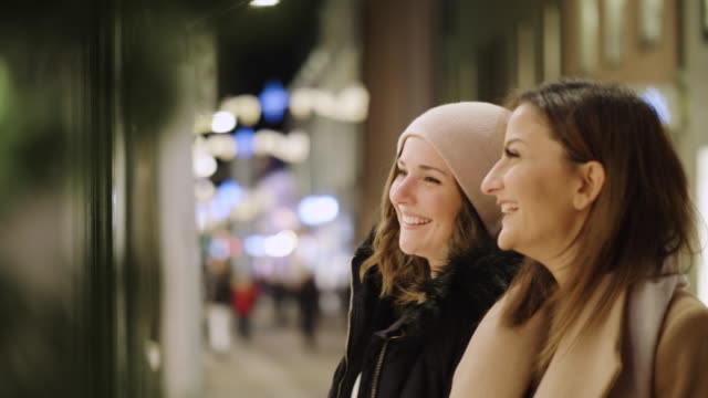 best friends are window shopping for christmas holidays - shopping bag stock videos & royalty-free footage