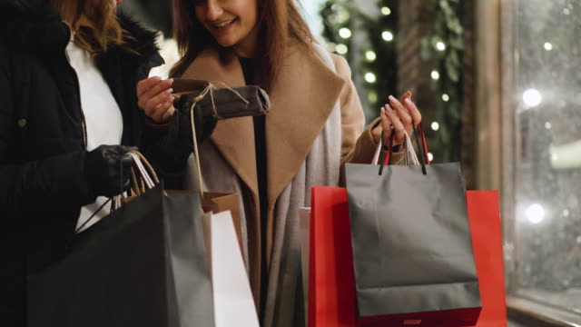best friends are window shopping for christmas holidays - merchandise stock videos & royalty-free footage