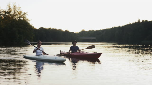 best friends canoeing at a lake. - beautiful people stock videos & royalty-free footage