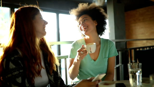 Best friends drinking coffee and talking