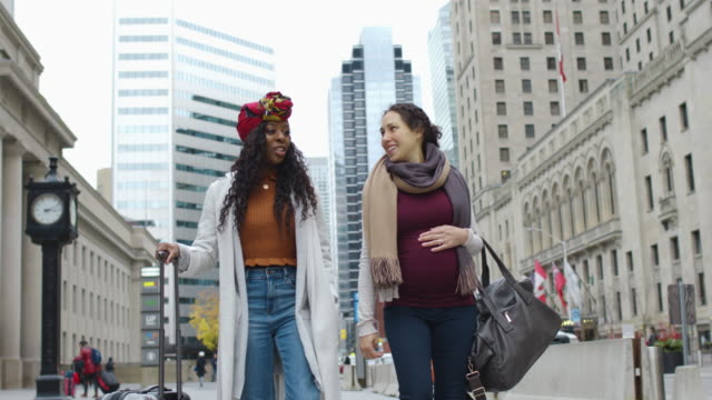 best friends exploring international city - toronto stock videos & royalty-free footage