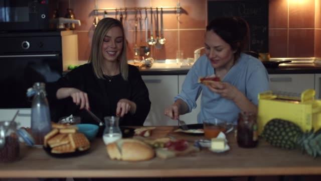best friends having breakfast at home - sandwich stock videos & royalty-free footage