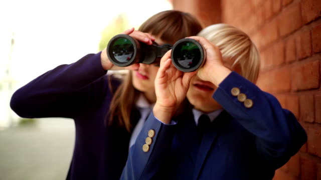 best friends playing with binoculars. - education stock videos & royalty-free footage