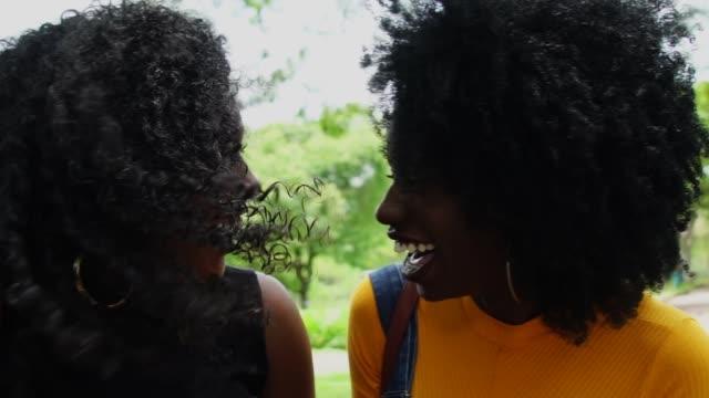 best friends walking in the park - black hair stock videos & royalty-free footage